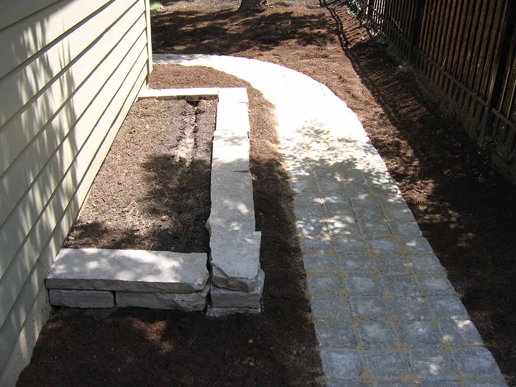 Webster Groves Fond-du-lac drywall planter and path of antiqued colonial cobble blocks