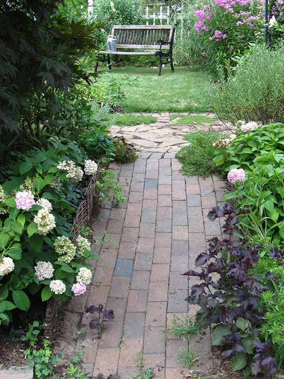 Webster Groves cottage garden - Brick walk and stone circle